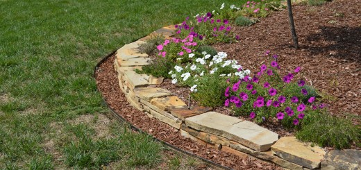 Here we edged the garden using a Tennessee stone and then used the aluminum edging so that the customer could easily mow.