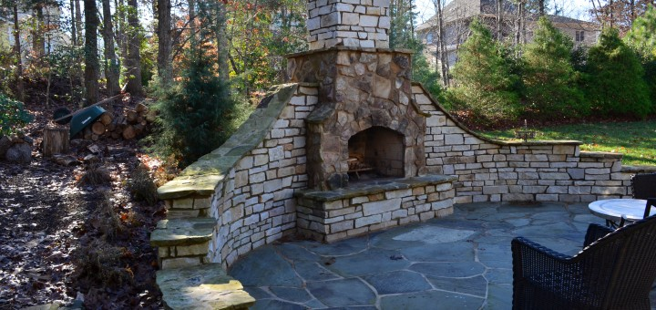 The walls on the side of the fire pit make the area much cozier.